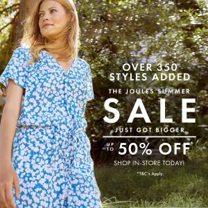 Woman in a blue floral Joules summer dress